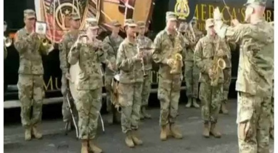 American soldiers play the national anthem of india